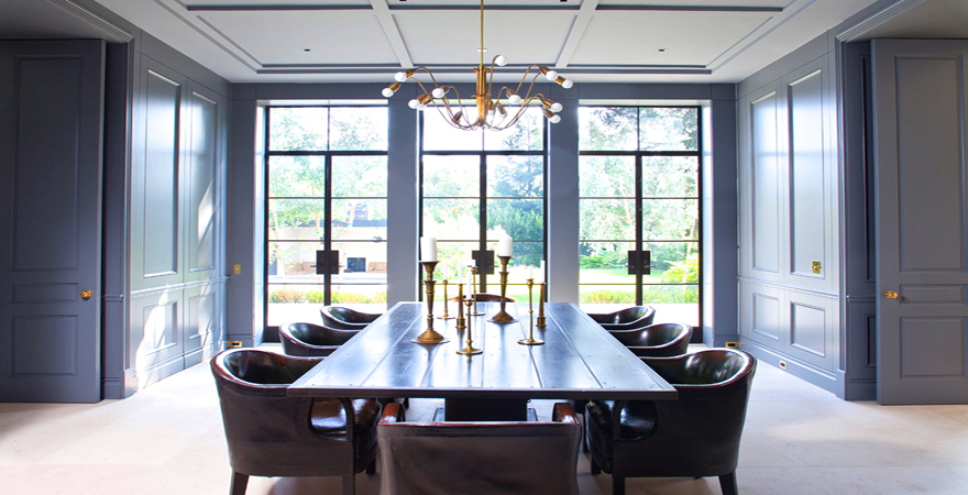 william-hefner-dining-room-paneled-walls-doors-gray-blue-cococozy-interior-design-leather-chairs-encasement-windows-interior-design-resized